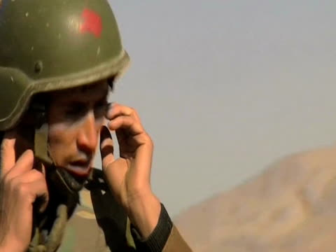 afghan troops during battle with insurgents afghanistan 28 january 2010 - 2001年~ アフガニスタン紛争点の映像素材/bロール