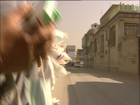 afghan woman sells her wares on the street - religiöse kleidung stock-videos und b-roll-filmmaterial