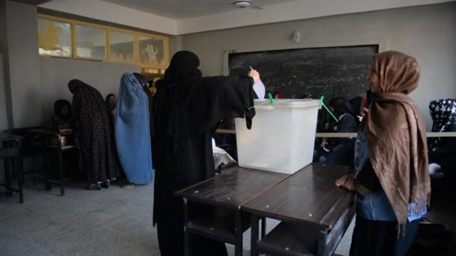 afghan women cast their vote at a polling centre in mazar-e-sharif for the country's legislative election that the taliban has vowed to attack - afghanistan stock videos & royalty-free footage