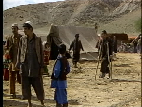 afghani refugees go about daily life in a refugee camp in northwest pakistan. - healthcare and medicine or illness or food and drink or fitness or exercise or wellbeing stock videos & royalty-free footage