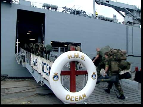 british troops may be deployed; uk pool held server ???: ext bv british royal marines boarding royal navy assault ship hms ocean royal marines to and... - itv late evening bulletin点の映像素材/bロール