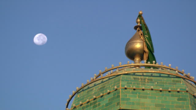 Afghanistan mosque with flag and moon.