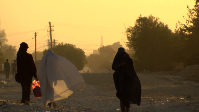 Afghanistan road, Afghan woman with burkha.
