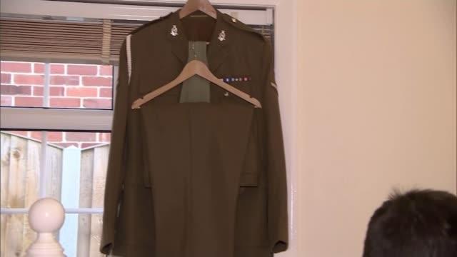 afghanistan veteran ben parkinson to recieve artificial legs ben parkinson interview sot military uniform hanging up pan parkinson and dernie pan... - 継父点の映像素材/bロール