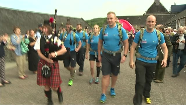 Afghanistan veterans begin Walking With The Wounded 1000 mile walk across Britain SCOTLAND EXT **Bagpipe music heard SOT** Afghanistan veterans and...