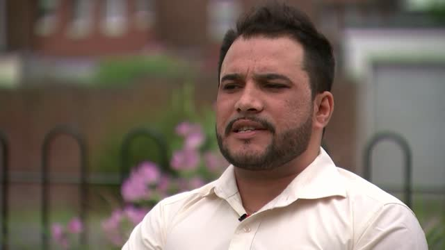 afghan civilians fear taliban revenge for helping the british; england: west midlands: coventry: ext jamal barak along with reporter and showing him... - war and conflict stock videos & royalty-free footage