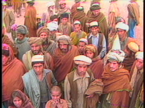 afghanistani refugees take refuge from the war between the rebels and the soviet occupation forces. - (war or terrorism or election or government or illness or news event or speech or politics or politician or conflict or military or extreme weather or business or economy) and not usa stock videos & royalty-free footage