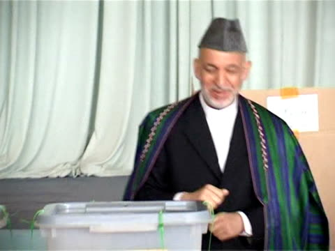 afghanistan's electoral authorities are expected to announce their decision on fraud allegations within days either with a declaration of who is to... - hold me tight stock videos & royalty-free footage