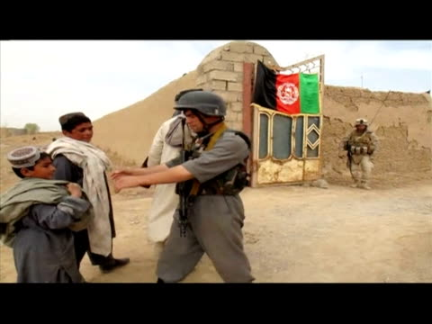 afghanistan's red, green and black flag was raised on thursday over the town of marjah, which is at the centre of a us-led offensive in the taliban... - provinz helmand stock-videos und b-roll-filmmaterial