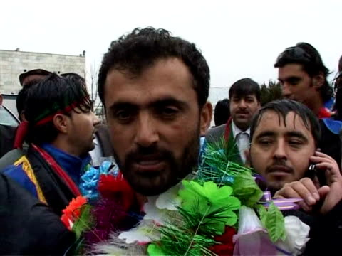 afghanistan's victorious cricket team returned home thursday to a rapturous welcome from hundreds of fans after securing a berth in the world... - afghanistan stock videos & royalty-free footage