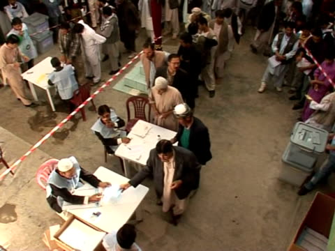 afghans braved sporadic rocket and bomb attacks to vote for a new parliament saturday with the warweary nation on full security alert after the... - bomb stock videos & royalty-free footage