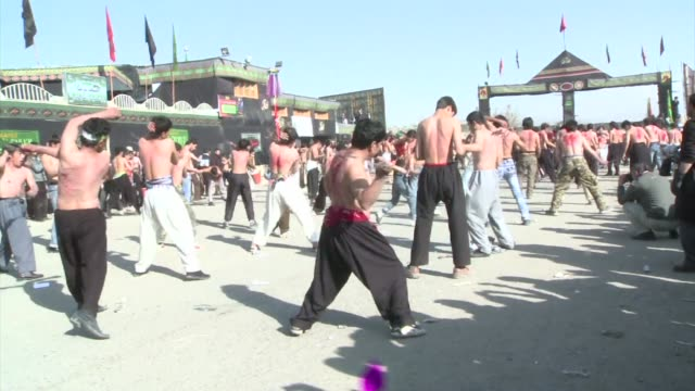 afghans celebrate ashura under tight security after last years celebrations were overshadowed by a suicide bomb attack that killed about 80 people... - ashura muharram stock-videos und b-roll-filmmaterial