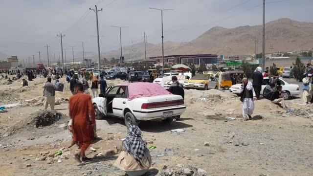 afghans continue to wait around the hamid karzai international airport as they try to flee the afghan capital of kabul, afghanistan on august 21,... - afghanistan stock videos & royalty-free footage