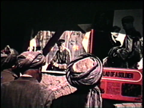 afghans looking at movie posters for soviet films / children on the sidewalk / traffic in the street. banner of the april revolution on january 01,... - afghanistan stock videos & royalty-free footage