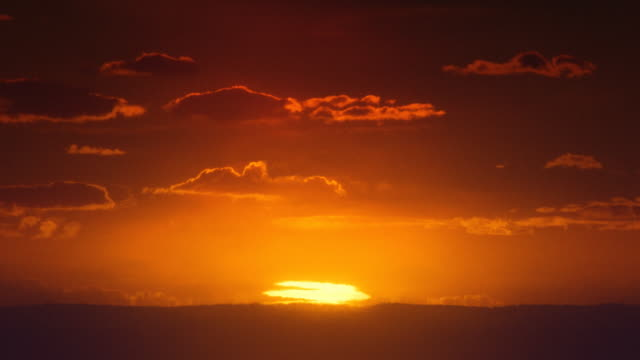 africa. african timelapse sunrise. sun inferior mirage. - red cloud sky stock videos & royalty-free footage