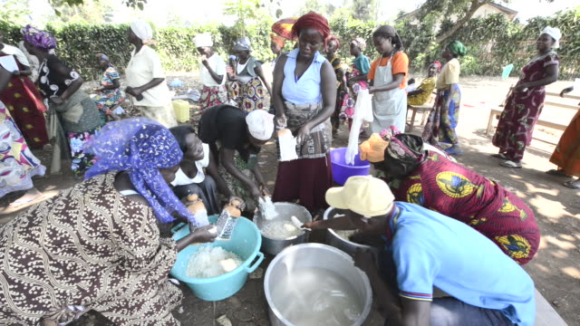 africa, drc, democratic republic of the congo, s. kivu, katana. women for women project. women making bread, cheese and snacks from the flour they make from their casava plants and soy milk processing. - soy milk stock videos and b-roll footage