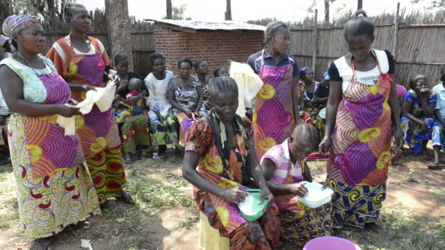 africa, drc, democratic republic of the congo, south kivu, kamanyola. women for women project. wfw kamanyola co-op and lifeskills training. women making soy milk & cassava products. - soy milk stock videos and b-roll footage