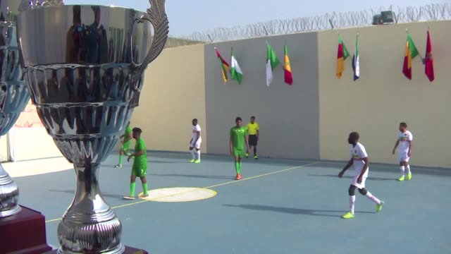 Africa Forever reads the banner over the gate of a jail for young offenders in Casablanca hosting the finals of a football tournament in tandem with...
