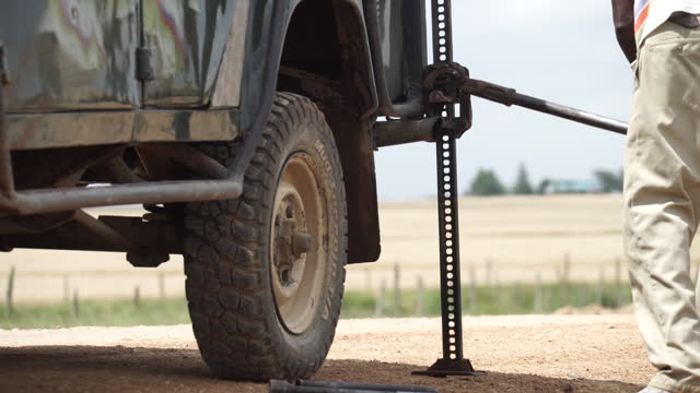 africa - lifting car with pump - machine part stock videos & royalty-free footage
