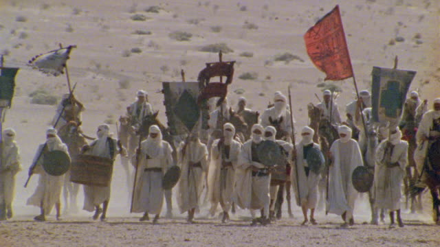 SLO MO, MS, Africa, Re-creation, Tuareg troops walking through desert