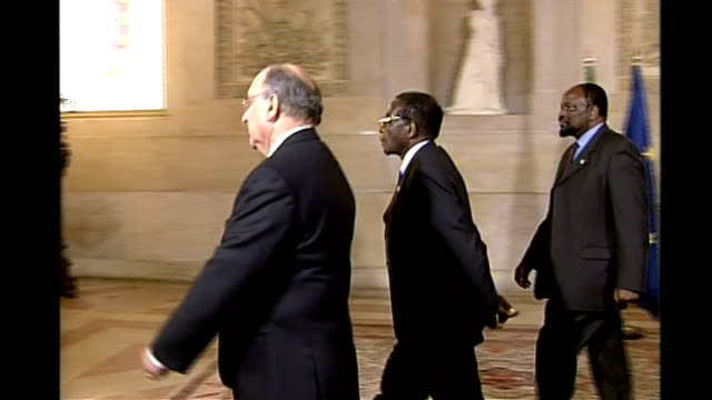 mugabe attacked; portugal lisbon: int eu and african leaders attending banquet at end of eu - africa summit meeting former un secretary general kofi... - secretary general stock videos & royalty-free footage