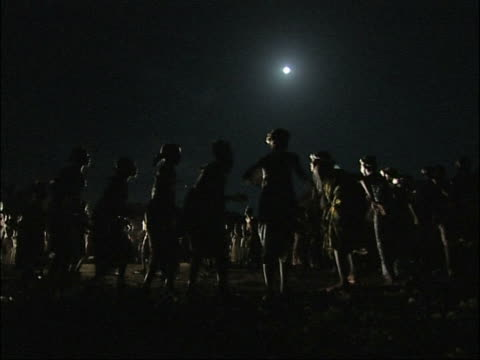 Africa, women dancing in the moonlight.