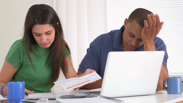african american and caucasian couple in debt - cheque financial item stock videos & royalty-free footage