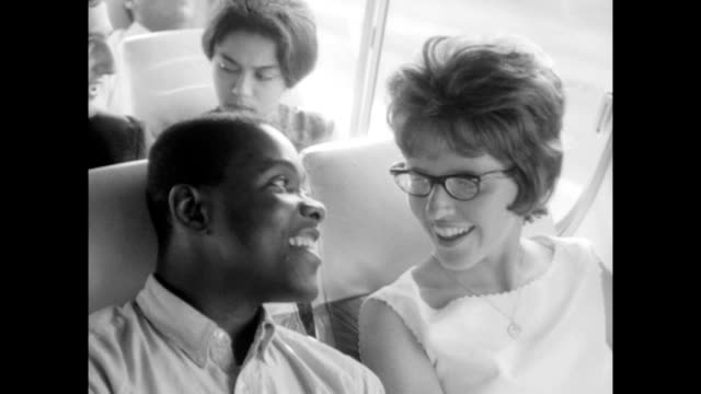vídeos de stock e filmes b-roll de / african american and caucasian people traveling on bus to attend the march on washington for jobs and freedom / people talking laughing and looking... - 1963