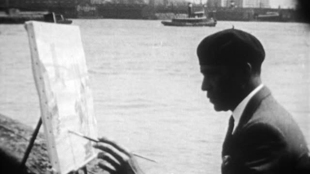 african american artist palmer hayden paints on the docks / cityscape with the words 'where there are opportunities for jobs study and cultural... - woolworth building stock videos & royalty-free footage