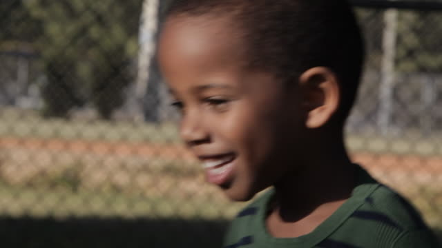 african american boy holding baseball - cheering stock videos & royalty-free footage