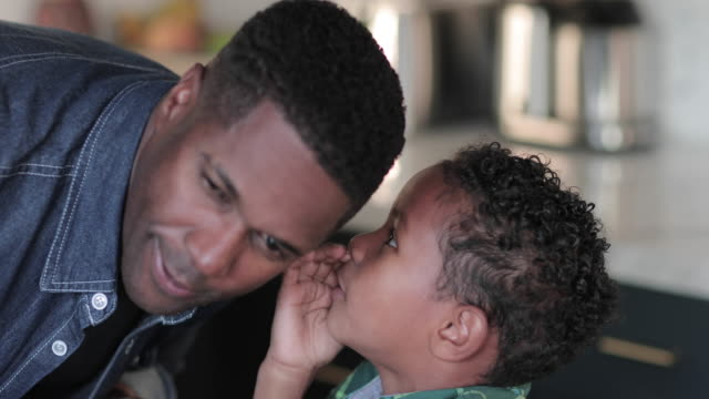 african american boy whispering in fathers ear - whispering stock videos & royalty-free footage