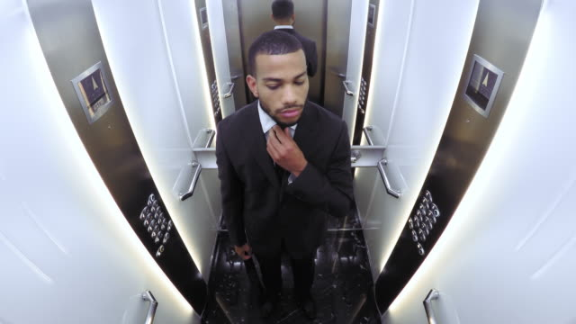 POV African American businessman in the elevator