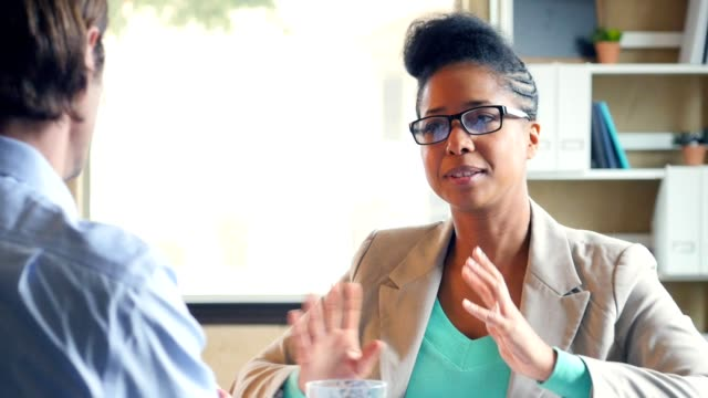 african american businesswoman talks with client in the office - pointer stock videos & royalty-free footage