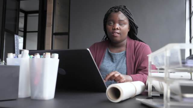 african american businesswoman with disability sits at desk using laptop, close up - expertise stock videos & royalty-free footage