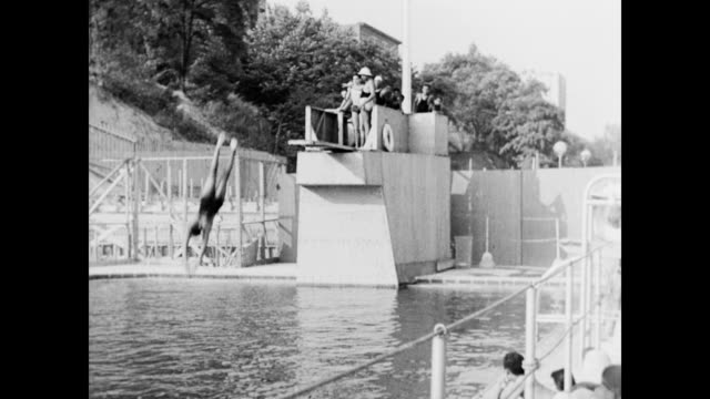 african american children playing in newly built wpa swimming pool / wading pool at colonial park / newly graded playground full of children /... - 1937 stock videos and b-roll footage