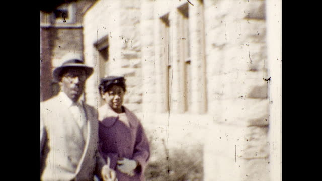 african american churchgoers walk down the sidewalk towards church. - church stock videos & royalty-free footage