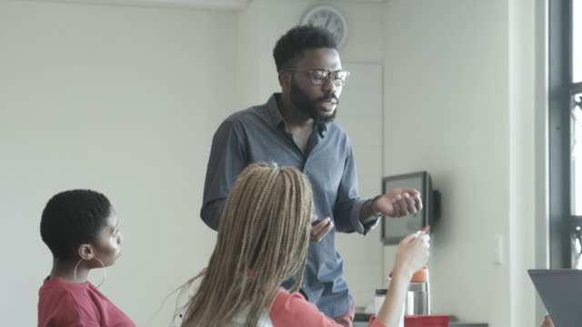 african american college professor in classroom, medium shot - lecturer stock videos & royalty-free footage