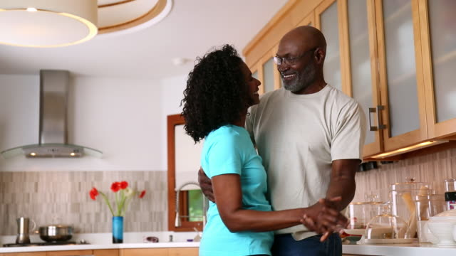 african american couple dancing in domestic kitchen - active lifestyle stock videos & royalty-free footage
