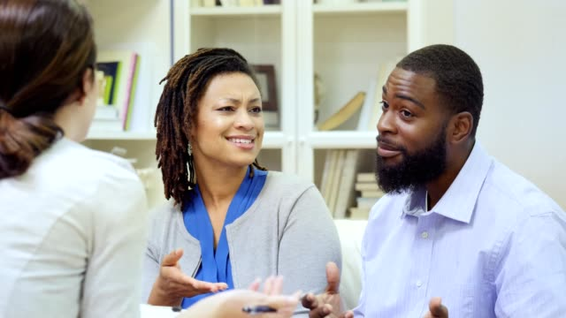 african american couple discuss issues with female therapist - black couple arguing stock videos & royalty-free footage