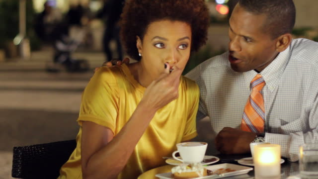 African American couple in cafe with dessert