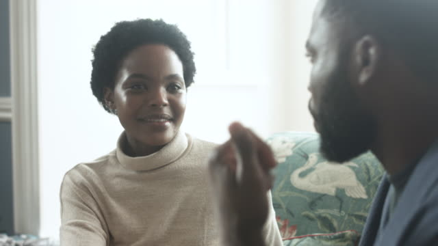 african american couple on sofa, close up - soft focus stock videos & royalty-free footage