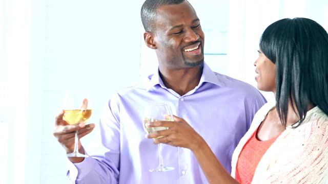 african american couple talking, toasting wine at home - mid adult couple stock videos & royalty-free footage