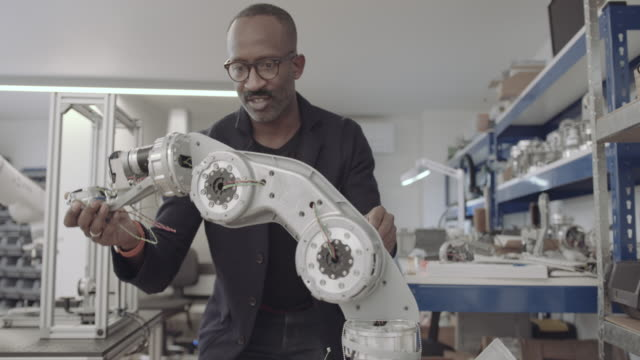 african american engineer building a robotic arm - stem topic stock videos & royalty-free footage