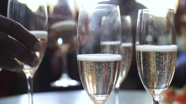 african american family takes champagne glasses, close up - refreshment stock videos & royalty-free footage