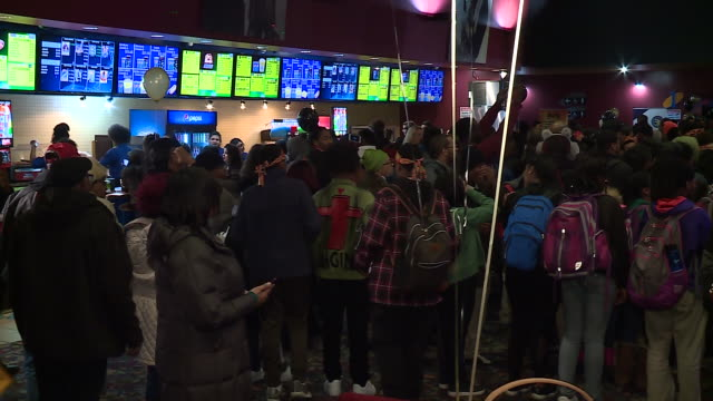 wgn african american fans pack theater entry at black panther movie premiere in chicago on february 15 2018 - black panther stock videos & royalty-free footage