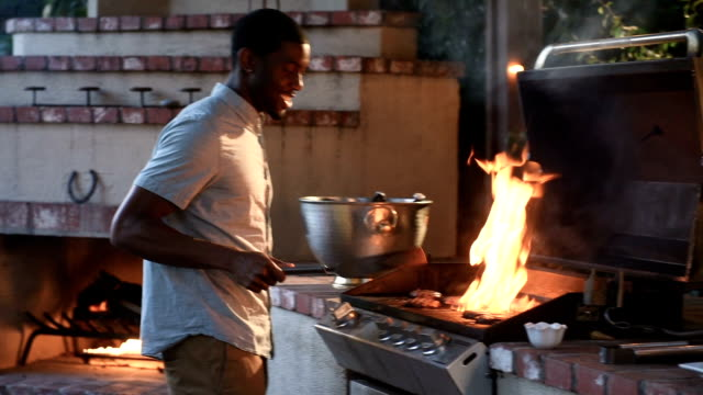 African American Male Grilling at a Summer BBQ