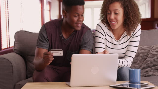 African American man and woman shop online