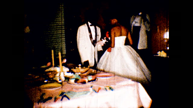 african american man in dress shirt takes some food from table, older woman takes food and eat as well; young couple in formal dress and suit taking... - senior women stock videos & royalty-free footage