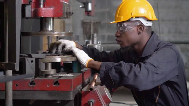 african american man working on the control panel works with an industrial machine at the factory close-up. industrial machinery,male engineers inspect the automation and control panels in the factory. - man and machine stock videos & royalty-free footage