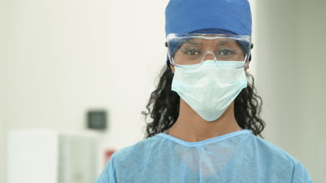 african american medical professional wearing protective equipment - nurse cap stock videos & royalty-free footage